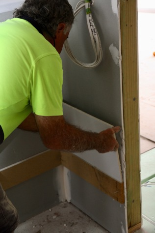 Laying the first tile